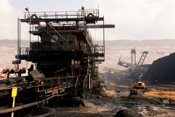 Excavator in mine stock photo