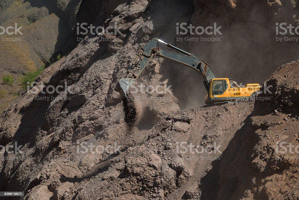 Excavator in mountains stock photo