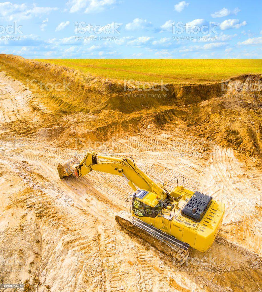 Excavator in open cast mine. stock photo