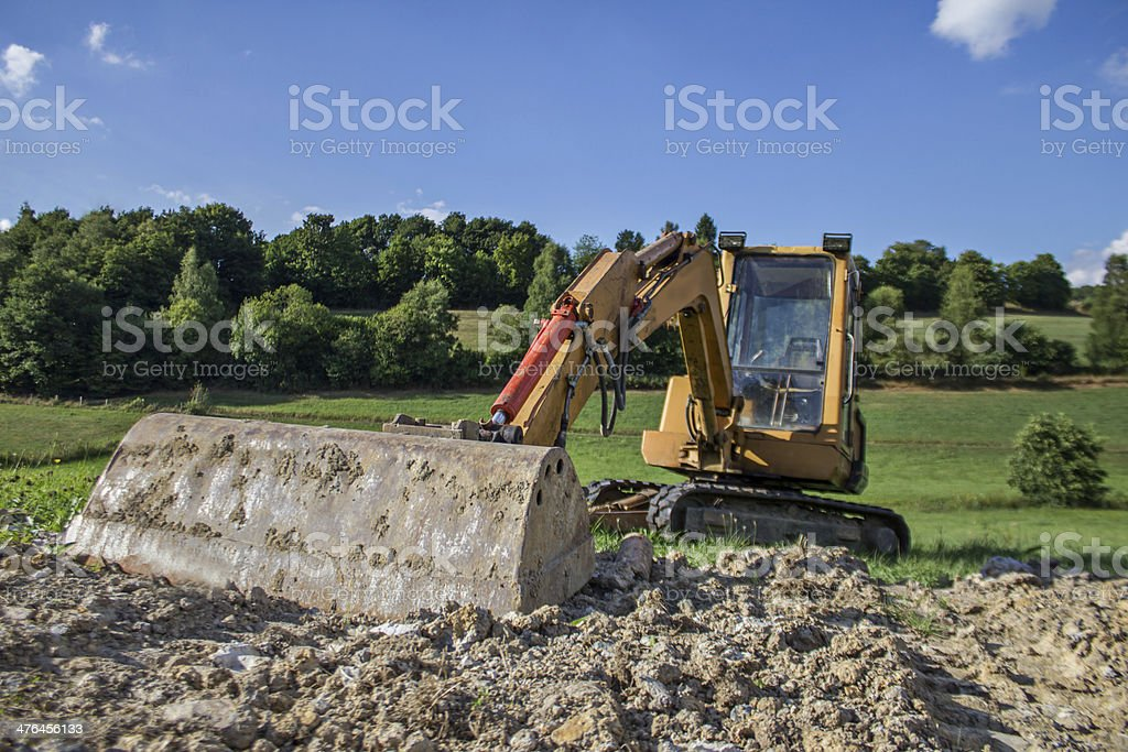 excavator in the countryside royalty-free stock photo