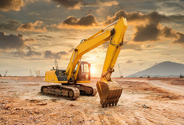 excavator loader machine during earthmoving works outdoors excavator loader machine during earthmoving works outdoors in sunset construction machinery stock pictures, royalty-free photos & images