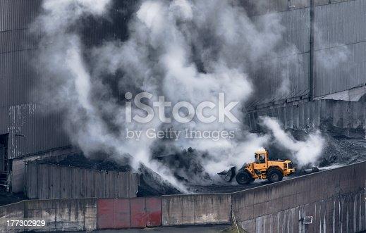 istock Excavator loadingsmolderingwaste   . 177302929
