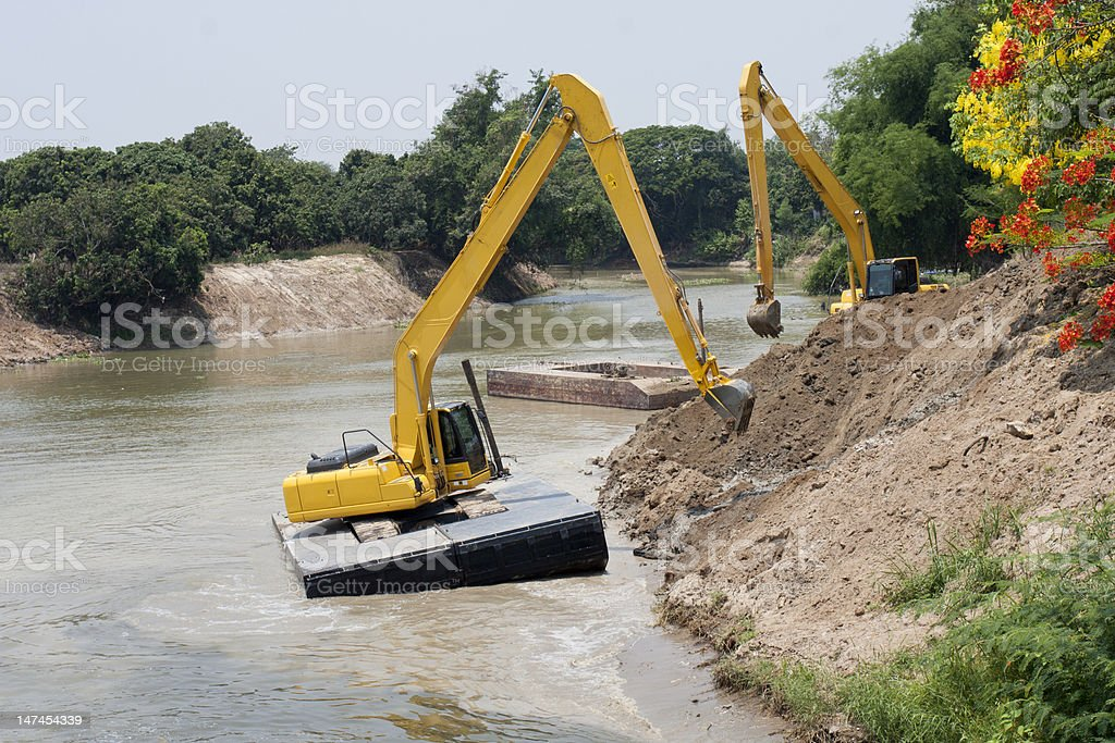 excavator machine group works at river for protect flood royalty-free stock photo