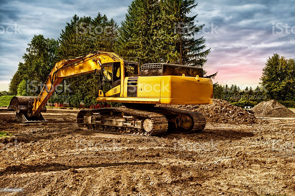Excavator machinery at construction site stock photo