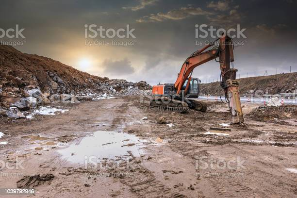Excavator moving earth and stone in the construction works of a road picture id1039792946?b=1&k=6&m=1039792946&s=612x612&h=5zpfb okrd15ivbgihja88fwhzsmr4o5mmycrkljbfi=