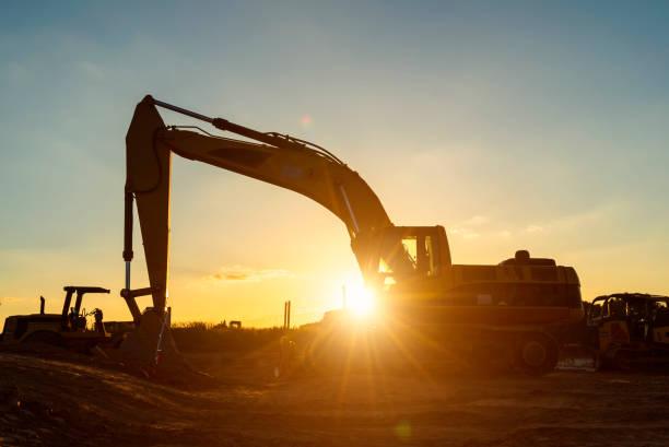 Excavator New Home Construction Job Site stock photo
