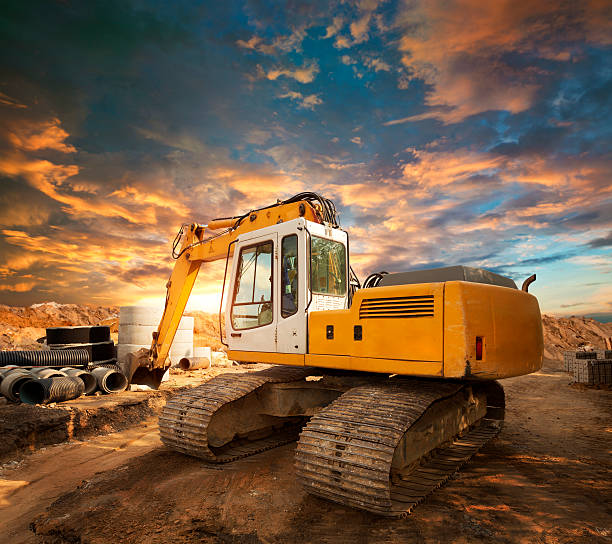 excavator on a construction site - land vehicle stock photos and pictures