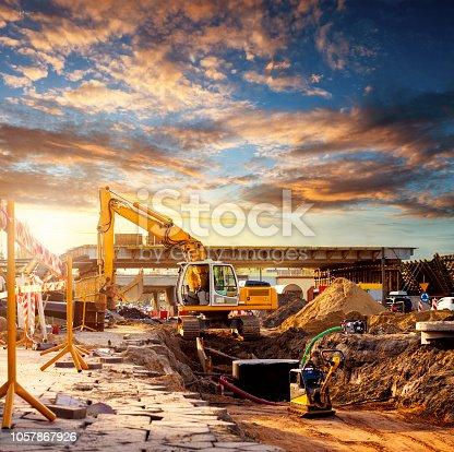 Large excavator caterpillar on a construction site. Excavator on a road construction site.