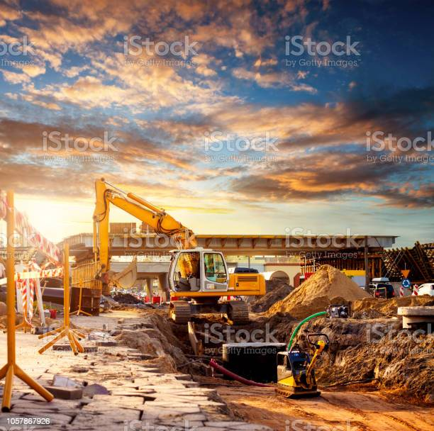 Excavator on a road construction site picture id1057867926?b=1&k=6&m=1057867926&s=612x612&h=1mgy9brx djjkd0sryzv caawwqxnxtdi  ofej1qa8=