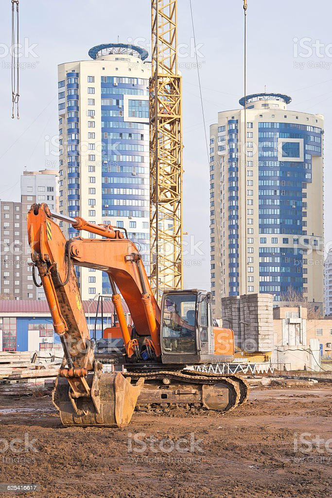 Excavator on building stock photo