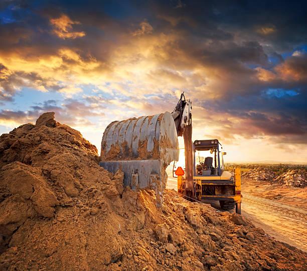 Excavator de construcción de carretera - foto de stock