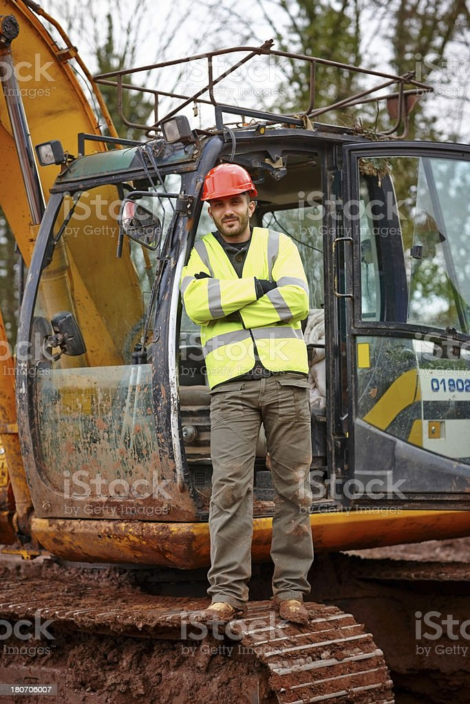 Excavator operator on a construction site royalty-free stock photo