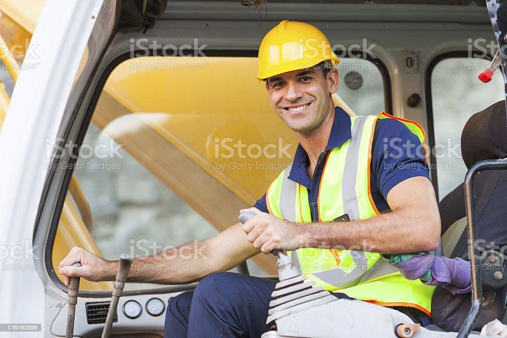 excavator operator stock photo