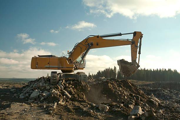Excavator with Full Shovel stock photo