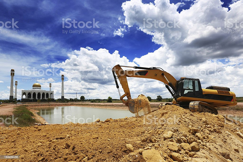 excavator work at the pond stock photo