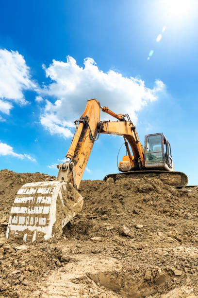 Excavator working at building site on sunny day stock photo