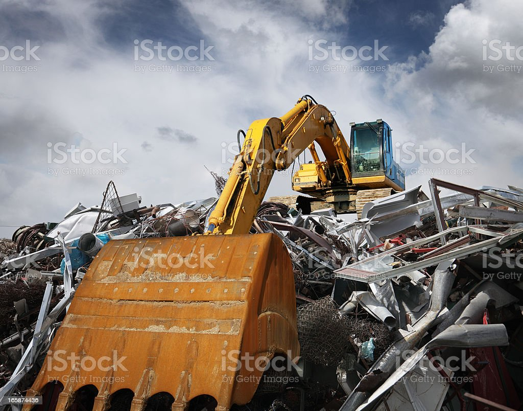 Excavator working at garbage dump stock photo