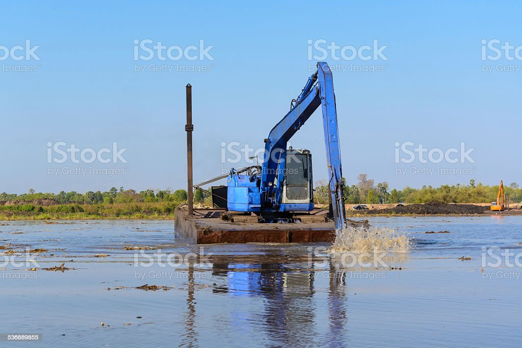 excavator working in the river stock photo