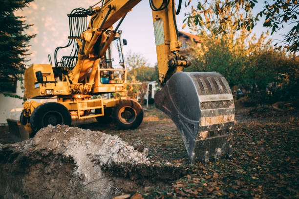 Excavator working in the yard stock photo
