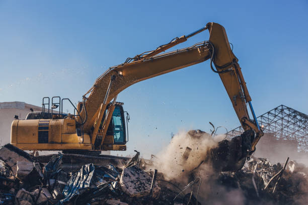 Excavator Working On a Demolition Site Excavator machinery working on a big demolition site of old building demolishing stock pictures, royalty-free photos & images
