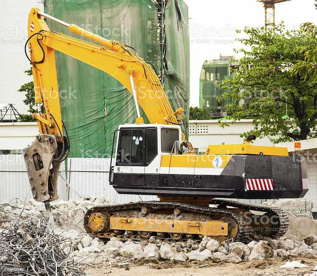 Excavator Working on Construction Site stock photo