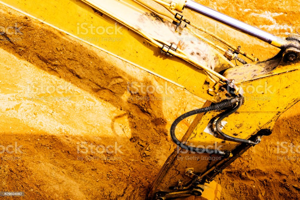 Excavator working with red soil and dusty stock photo