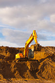 Excavator works in a quarry. Construction machinery.