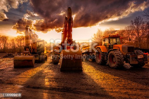 excavators and a truck at construction site