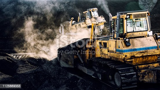 508140747 istock photo Excavators are working, coal mining, dirty job 1125889353