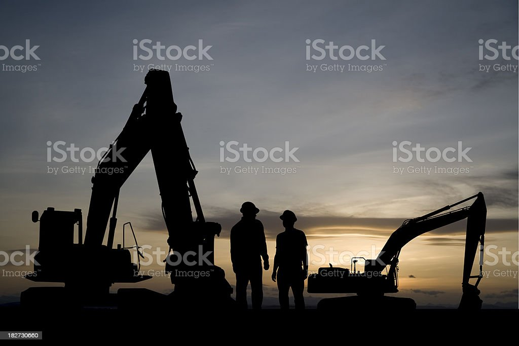 Excavators at Dawn stock photo