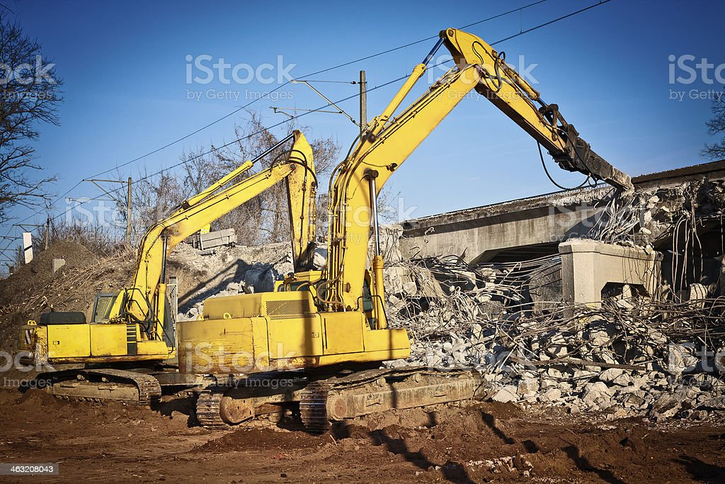 Excavators destroy the old viaduct royalty-free stock photo