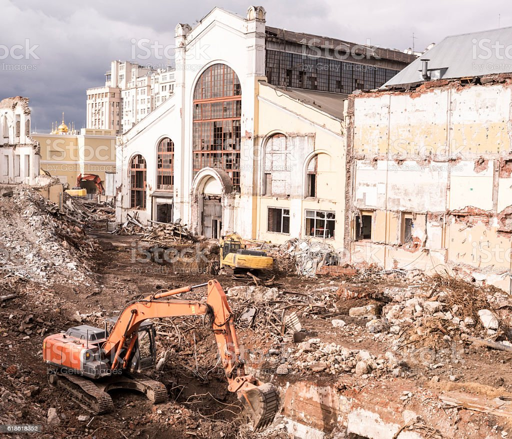 Excavators destroying the building in the center of Moscow stock photo