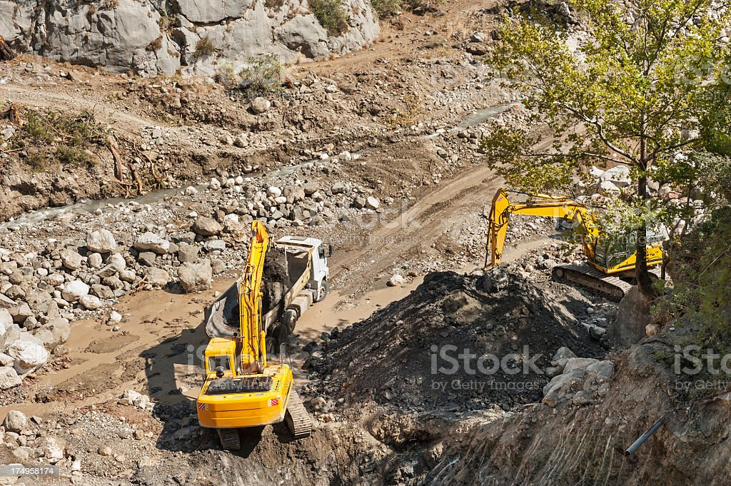 excavators working in river bed royalty-free stock photo