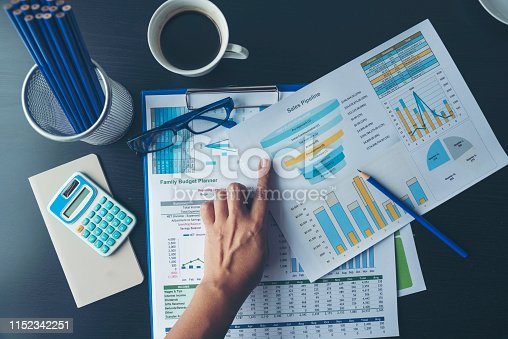 Excel Spreadsheet stats graph analytics data. Accountant hands holding Financial Document Trading Information with excel file. Finance statistic report analyze business graph, chart,database,report.