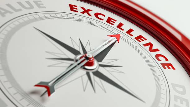 excellence concept: arrow of a compass pointing excellence text - perfection stock pictures, royalty-free photos & images