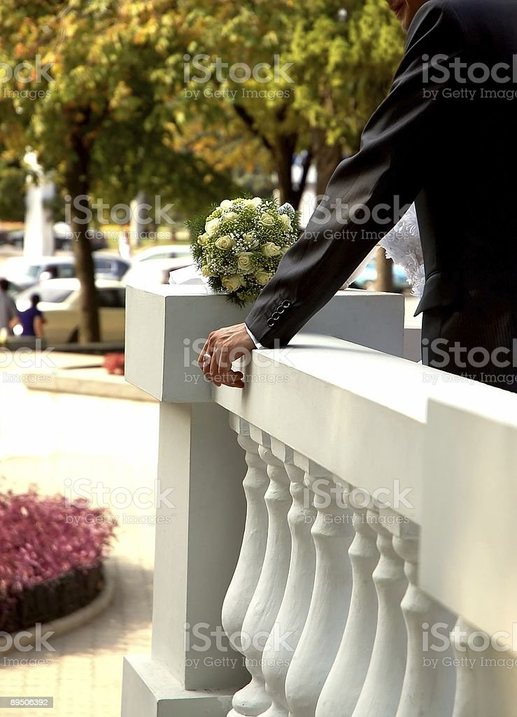 Excellently dressed  man and a wedding bouquet royalty-free stock photo