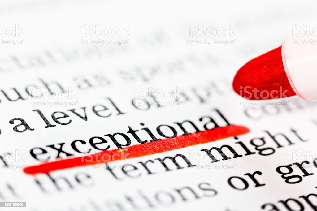 'exceptional' underlined in red felt-tip in printed document stock photo