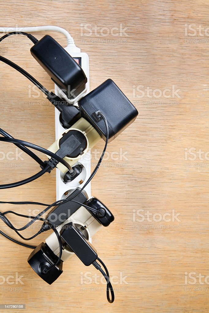 Excessive extension on power outlet royalty-free stock photo