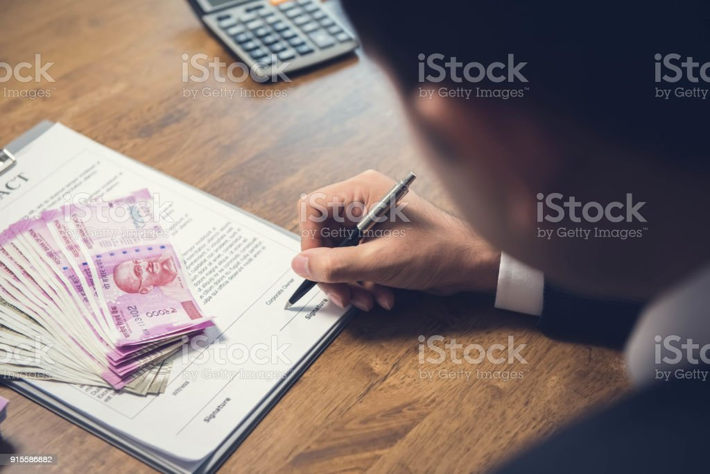 Exchange agreement with Indian Rupees stock photo