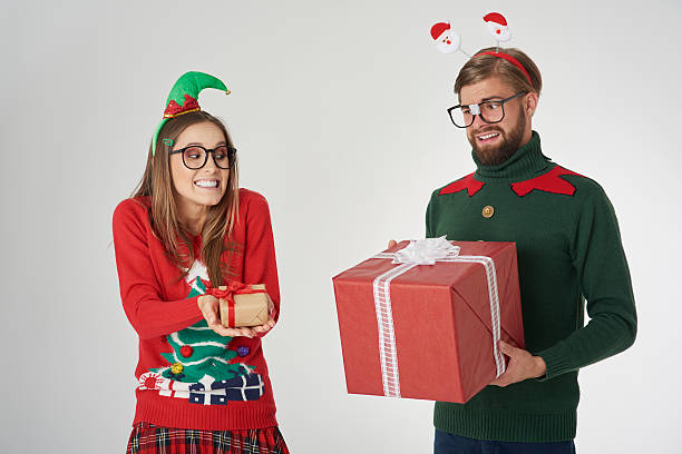 Royalty free gift exchange pictures images and stock photos istock exchange of big and small christmas presents stock photo negle Choice Image