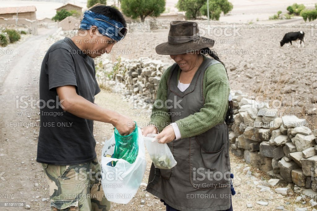 Exchange of coca leaves is a daily greeting like shaking hands. October 6, 2012 - Maragua, Sucre, Bolivia stock photo