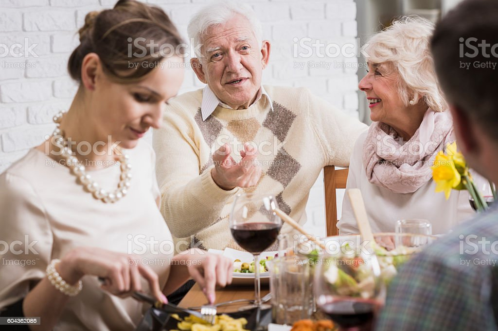 Exchange of views with loved ones honored by meal stock photo