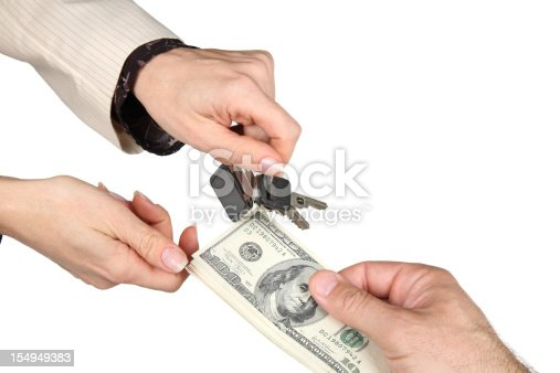 Exchanging car keys for money-isolated on white background