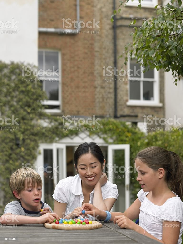 Exchange student playing game with children royalty-free stock photo