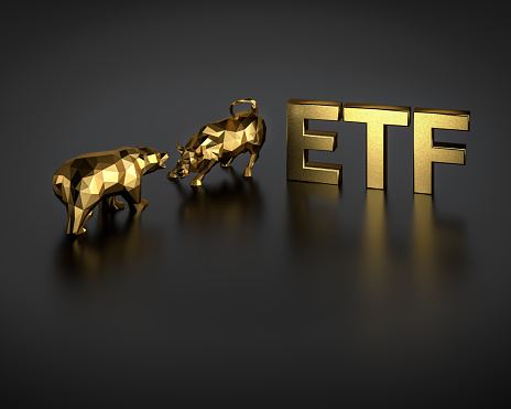 Exchange traded fund concept. A bull and bear besides the golden text ETF.