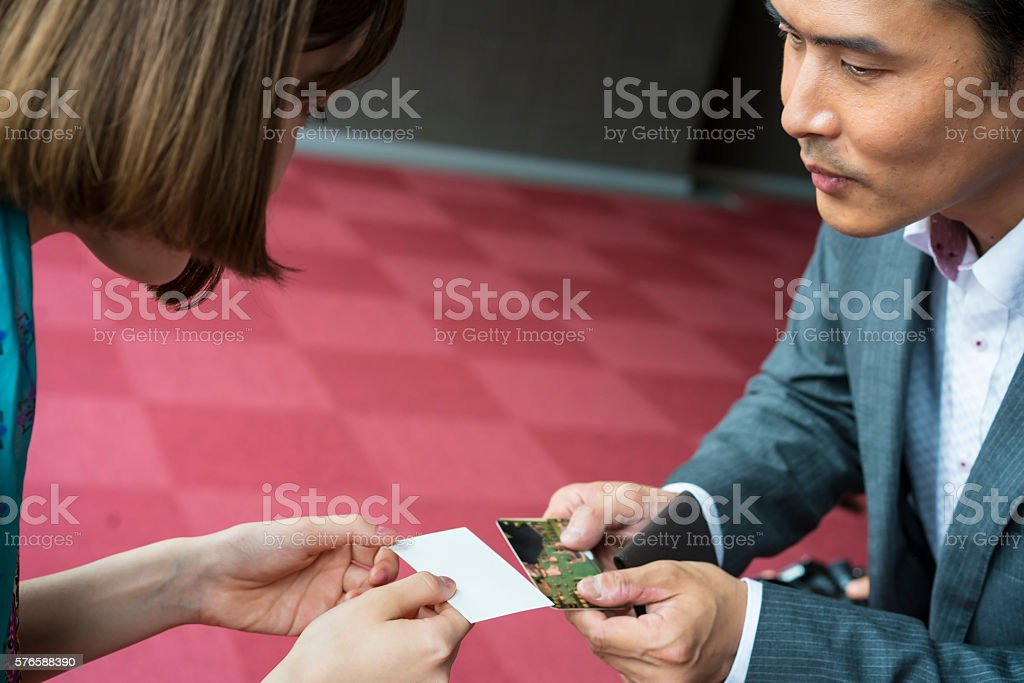 Exchanging Business Cards In Office Hall Kyoto Japan Stock Photo