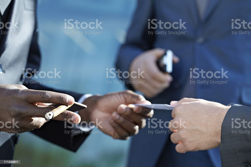 Exchanging business cards stock photo more pictures of adult istock exchanging business cards royalty free stock photo colourmoves