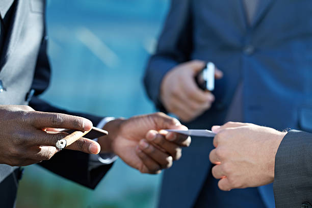 Royalty free closeup of businessman exchanging business card exchanging business cards stock photo colourmoves
