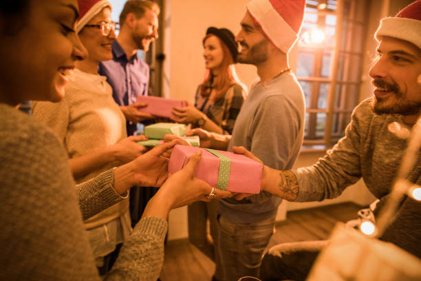 Exchanging Christmas gifts at office party! stock photo