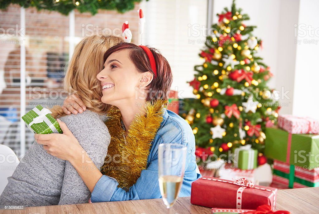 Exchanging Christmas Gifts By Two Young Women Stock Photo & More ...